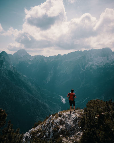 Triglav National Park An Eye For Travel Adventure Backpack Beauty In Nature Cloud - Sky Day Full Length Hiking Leisure Activity Lifestyles Men Mountain Mountain Range Nature One Person Outdoors People Real People Rear View Scenics Sky Standing Tranquil Scene Tranquility Water