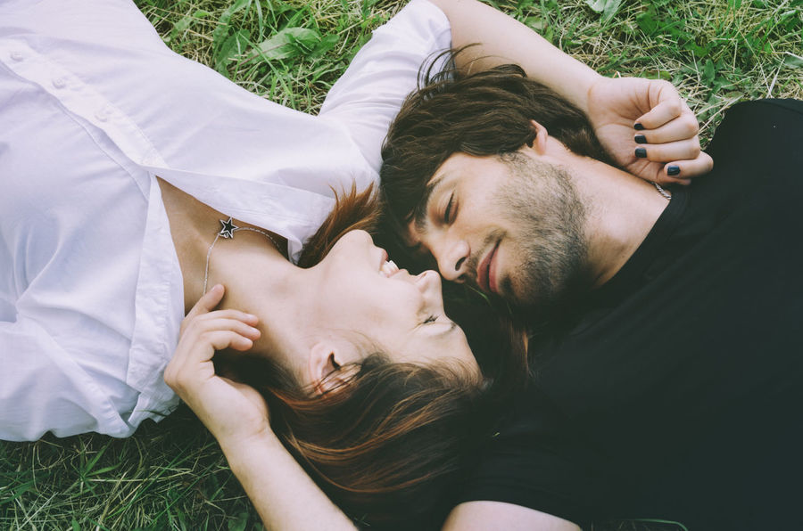Couple in love on the grass Couple Hug Love Relationship Bonding Boyfriend Couple - Relationship Girlfriend Grass High Angle View In Love Leisure Activity Lifestyles Love Lying Down Lying On Back Men Nature People Real People Togetherness Two People Women Young Men Young Women
