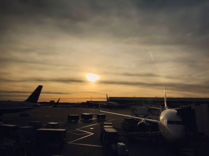 Transportation Airplane Sky Sunset Sun Mode Of Transport Air Vehicle Cloud - Sky Runway Airplane Wing Day Travel Traveling Airport Airport Gate Airport Photography Airport Terminal Luggage Cart  Luggage Trolleys The City Light Let's Go. Together. Investing In Quality Of Life