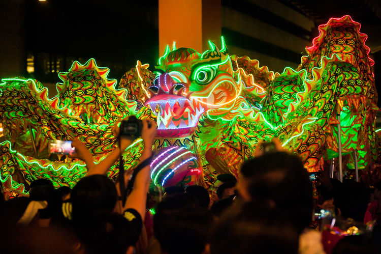 Arts Culture And Entertainment Audience Celebration Chinese Dragon Crowd Dragon Enjoyment Excitement Fun Illuminated Indoors  Large Group Of People Leisure Activity Lifestyles Men Multi Colored Night People Performance Real People Tradition Traditional Dancing Traditional Festival