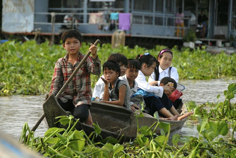 Children Of The World are Faces Of EyeEm -here on a Boat Starting A Trip home after school. Taking Photos Traveling Cambodia close to Siemreap . Travelling People