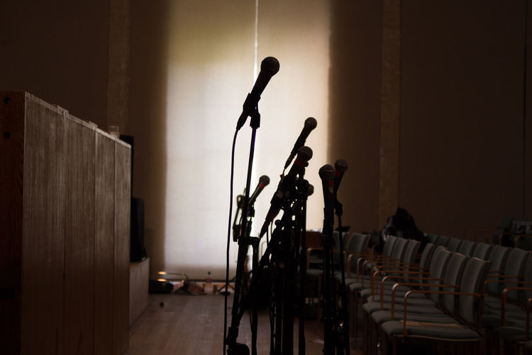Close-Up Of Microphones In Seminar Hall