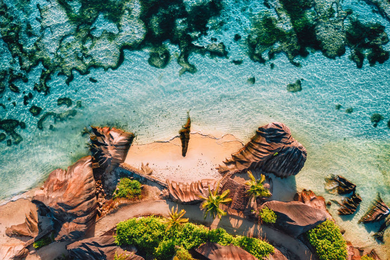 Aerial view of rocks at beach in island