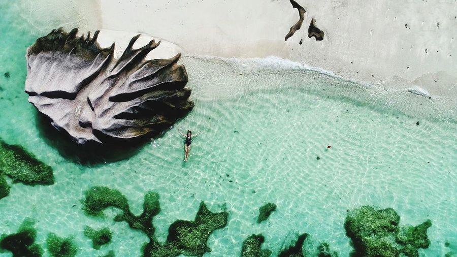 High angle view of woman relaxing at beach