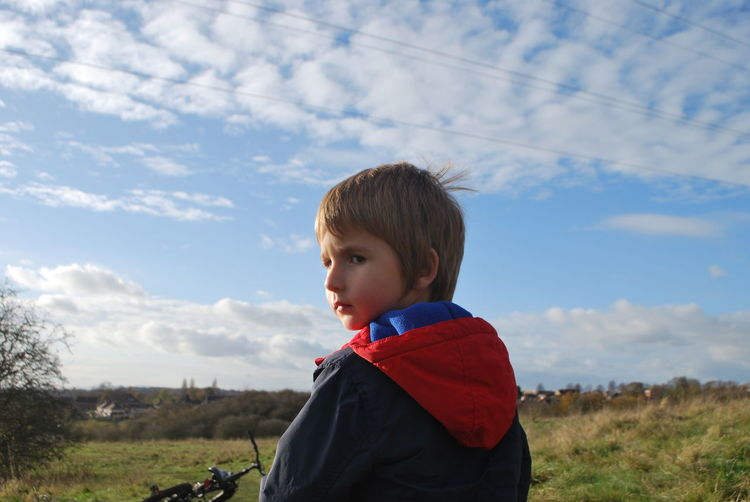 looking back EyeEm Selects Child Childhood Portrait Sky Cloud - Sky