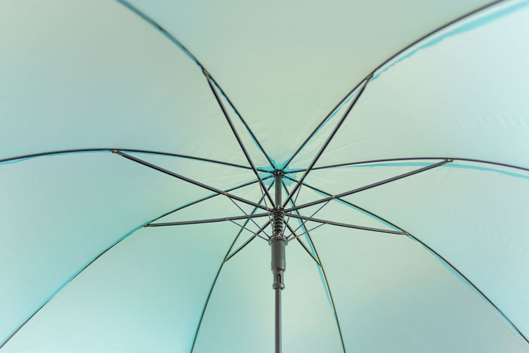 Low Angle View Blue No People Sky Full Frame Backgrounds Day Protection Metal Clear Sky Nature Close-up Umbrella Security Outdoors Pattern Connection Shelter