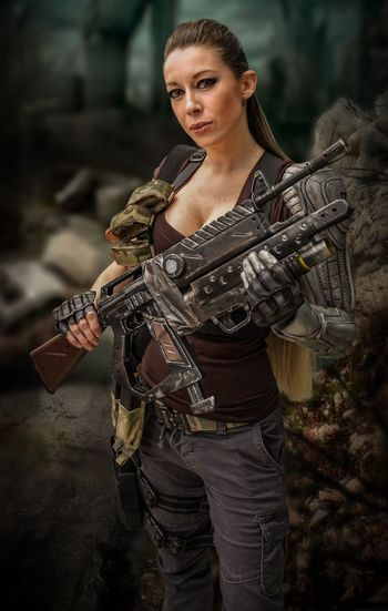 NYCC 2018 Cosplayer Cosplay NYCC Holding Gun Young Adult Three Quarter Length Weapon Real People One Person Rifle Focus On Foreground Young Women Clothing Looking At Camera Portrait