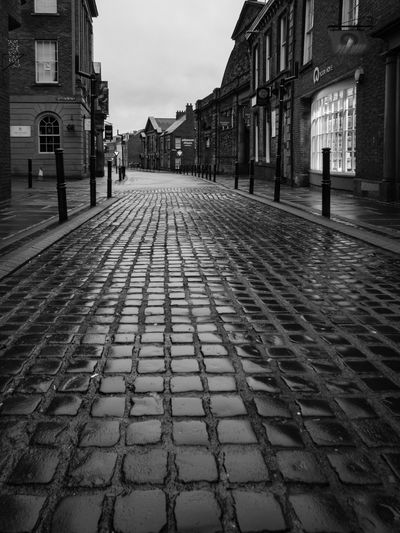 Cumbria Road Architecture Blackandwhite Photography Building Exterior Built Structure City Cobblestone Day Lit Window Monochrome No Cars  No People Outdoors Rainy Rainy Day Sky Street