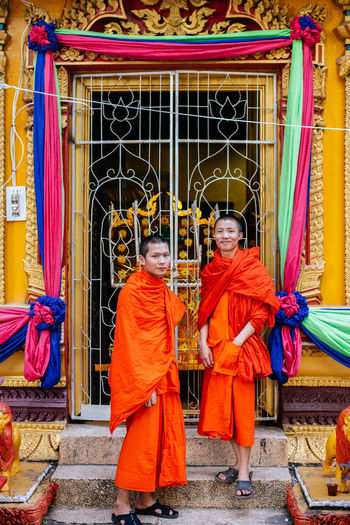 Showcase: January Two young Monks at Wat Si Muang Temple - Vientiane, Laos Journey Good Times Street Photography