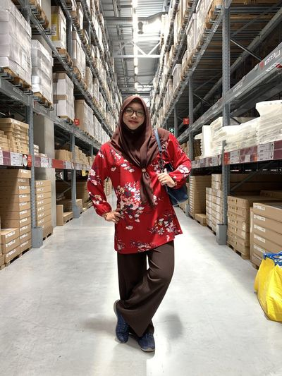 Portrait of woman standing in warehouse