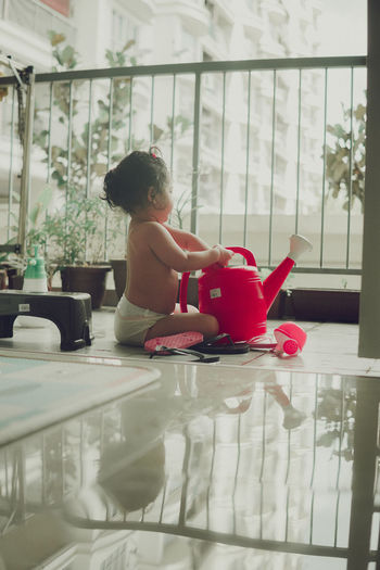 Boy playing with toy at home