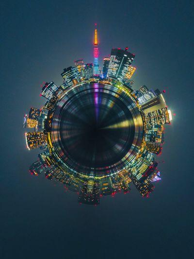 Digital composite image of illuminated building against sky at night