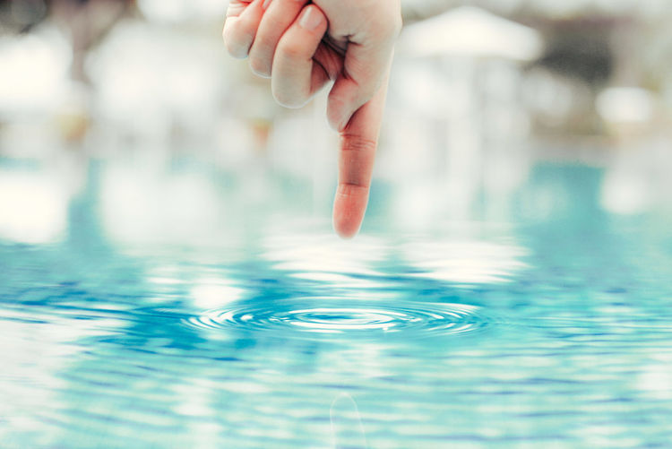 Low section of child in swimming pool