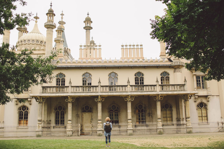 Arch Architectural Column Architecture Blonde Brighton Building Exterior Built Structure City City Life Curly Hair Day Dome Façade Girl Grass Lawn Leisure Activity Lifestyles Outdoors Royal Pavilion Royal Pavilion Gardens Tourism Tourist Travel Destinations Tree Connected By Travel