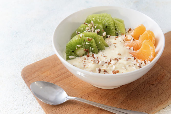 Breakfast Diet Eating Snack Spoon Bowl Curd Cheese Cutting Board Day Food Food And Drink Freshness Fruits Healthy Healthy Eating Kiwi Linseed Low Carb Oil Omega 3 Protein Quark Ready-to-eat Tangerine