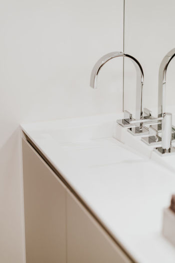 Faucet Sink Home Bathroom Indoors  Domestic Bathroom Domestic Room Household Equipment Hygiene Home Interior Neat Modern Architecture Elégance No People Luxury Built Structure Flooring Metal Wealth Wash Bowl Purity