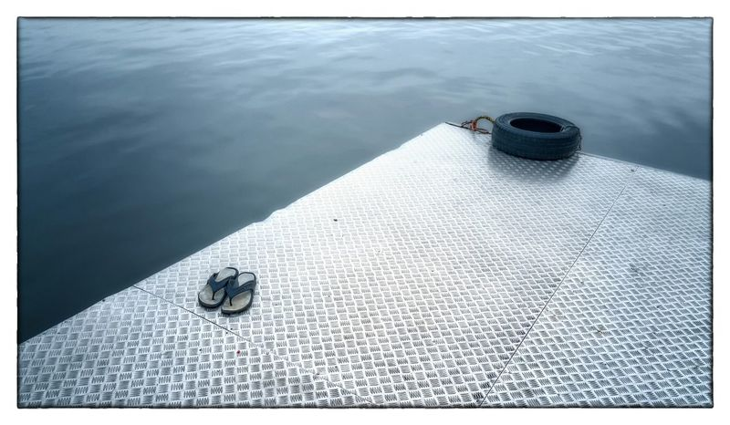 December scene on the small Danube pier Still Life Stillife River Riverside Water Slippers Tire Outofplace Out Of Place  Misplaced