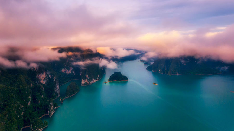 Rainforest with limestone mountains surrounding. Sunrise In the south of Thailand Cloud - Sky Scenics - Nature Sky Beauty In Nature Water Tranquil Scene Tranquility Nature Fog No People Sea Environment Dusk Sunset Aerial View Landscape Outdoors Land Lagoon