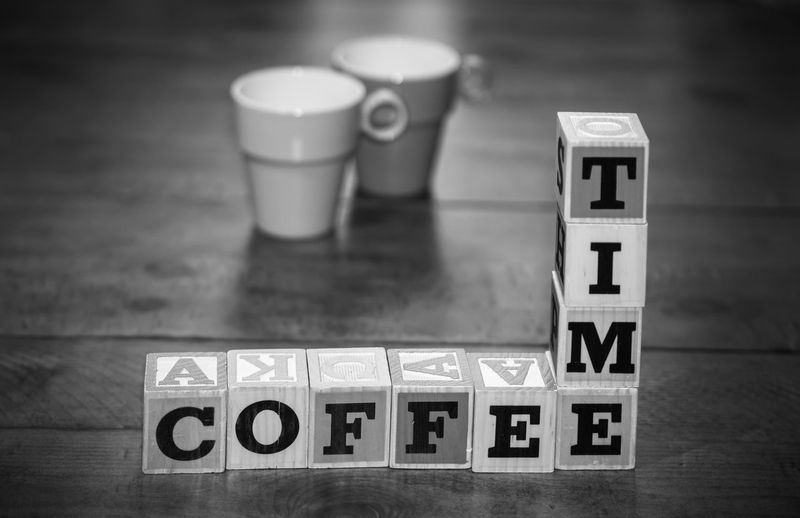 Beverage Blocks Coffee Time Liquid Black And White Break Time Cafe Close-up Coffe Communication Day Drink Focus On Foreground Indoors  No People Relax Rest Restaurant Still Life Table Tablecloth Text Toy Block Western Script Wood - Material
