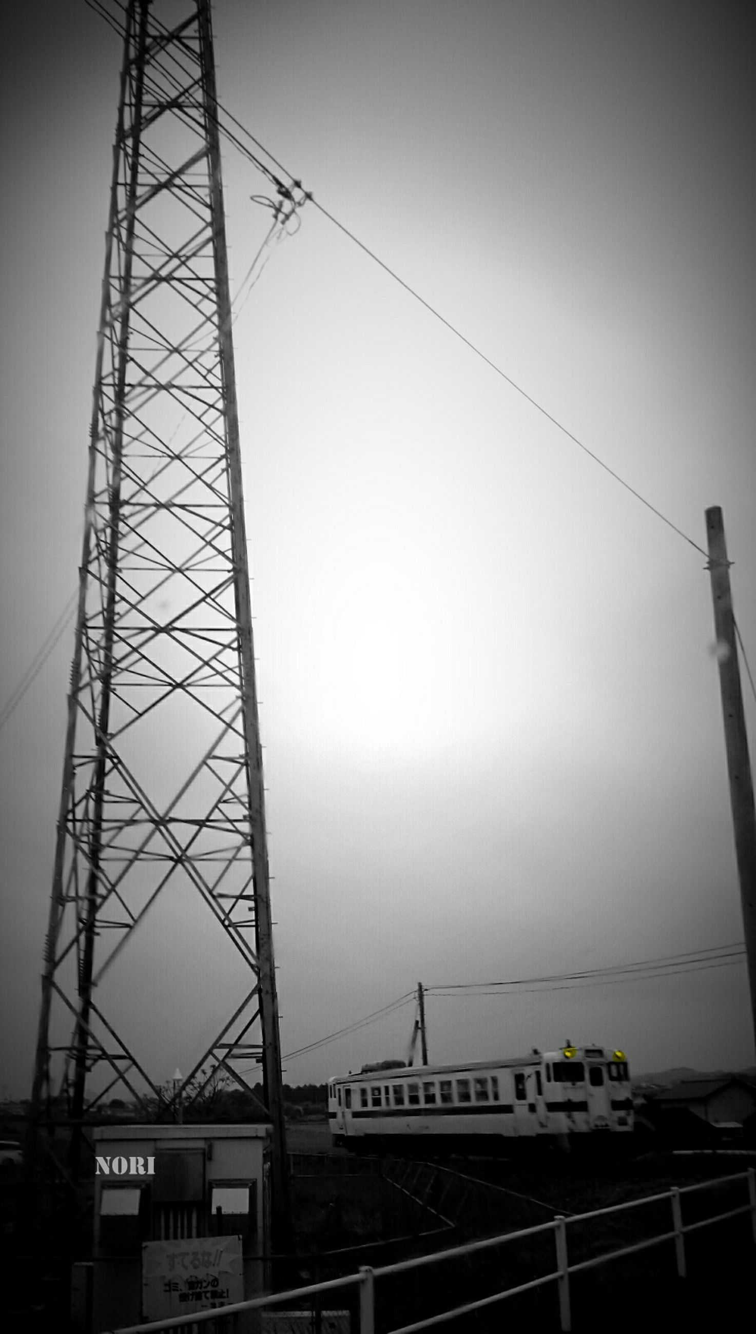connection, transportation, low angle view, power line, electricity pylon, power supply, cable, sky, communication, electricity, clear sky, technology, text, fuel and power generation, built structure, rail transportation, outdoors, dusk, no people, public transportation