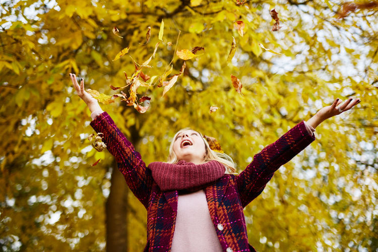 Adult Adults Only Arms Raised Arts Culture And Entertainment Autumn Branch Day Focus On Foreground Human Arm Human Body Part Leaf Leisure Activity Limb Nature One Person One Woman Only One Young Woman Only Only Women Outdoors Real People Scarf Standing Tree Young Adult Young Women