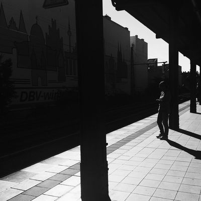 Shadow Full Length Walking Sunlight Built Structure Architecture City Rear View Street Lifestyles Outdoors Silhouette Person Public Transportation Berlin Street Photography Blackandwhite Moritzdornphotos Iphonephotography (null)Berlin Life Berlinlove Berlindubistsowunderbar