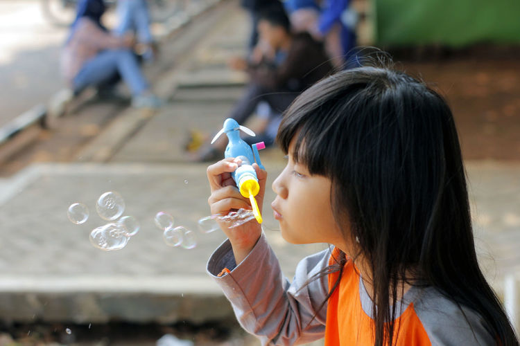 Portrait of girl with bubbles