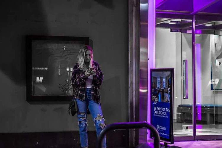 Female waiting for friends. Store Window Adult Fashion Lifestyles Store One Person Business Finance And Industry One Woman Only Only Women Adults Only People Young Adult Beauty Human Body Part Indoors  One Young Woman Only City Night Purple ♥ Bluejeans Kinda Girl Flannel Shirt waiting game Blond Hair Philly Howard Roberts