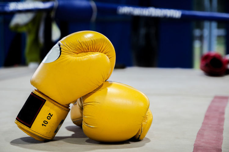 Close-Up Of Gloves In Boxing Ring