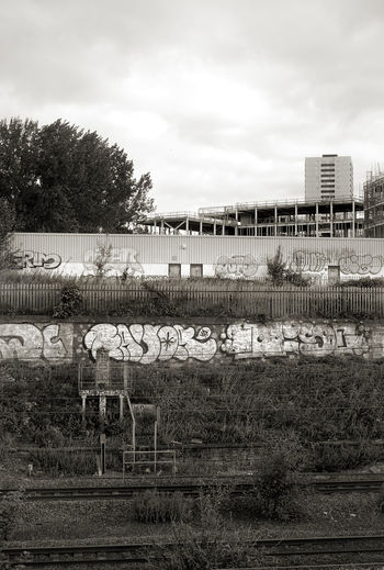 its Grim up north. Cloud Cloud - Sky Cloudy Day Grass Growth Landscape Nature No People Outdoors Plant Sky Tower Block, Railway Line, Graffiti, Tree Weather