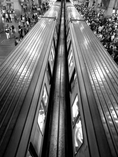 High angle view of people on escalator in city