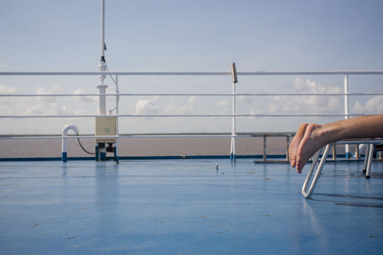 On board Blue Cruise Ship Feet Legs Lifestyles Lying Down Ocean On Board One Person Relaxation Relaxing Moments Sea Sunshine Travel Weekend Activities