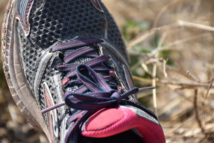 Turnschuh Focus On Foreground One Person Close-up Day Human Body Part Nature Outdoors Real People Plant High Angle View Shoe Leisure Activity Human Leg Land Body Part Field Shoelace Clothing Activity Turnschuhe Sneakers Shoe