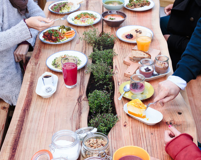 healthy eating Eating Bowl Day Eating Food Food And Drink Freshness Friendship Healthy Eating High Angle View Human Body Part Human Hand Lifestyles Men Outdoors People Plate Ready-to-eat Real People Sitting Table Togetherness Wood - Material