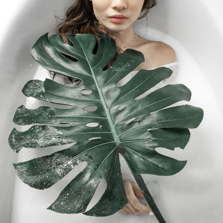 Adult Bathtub Close-up Day Green Color Human Body Part Indoors  Leaf Lying Down Milk One Person Peaceful People Plants Portrait Of A Woman Portraits Portraiture Studio Studio Shot Submerged White Background Women Women Who Inspire You Young Adult Young Women