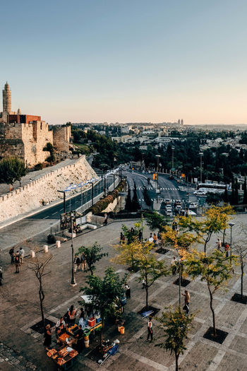 A city view of Jerusalem Travel Wall Architecture Building Exterior Built Structure City Cityscape Clear Sky High Angle View Israel Jerusalem Old Buildings Outdoors Scenics Sky Street Streetphotography Sunset Tourism Travel Destinations Tree Mobility In Mega Cities EyeEmNewHere