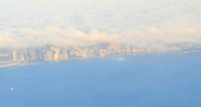 Is the city on fire or are those clouds just making a beautiful illusion? Plane's Eye View Shoreline 35000ft On The Way