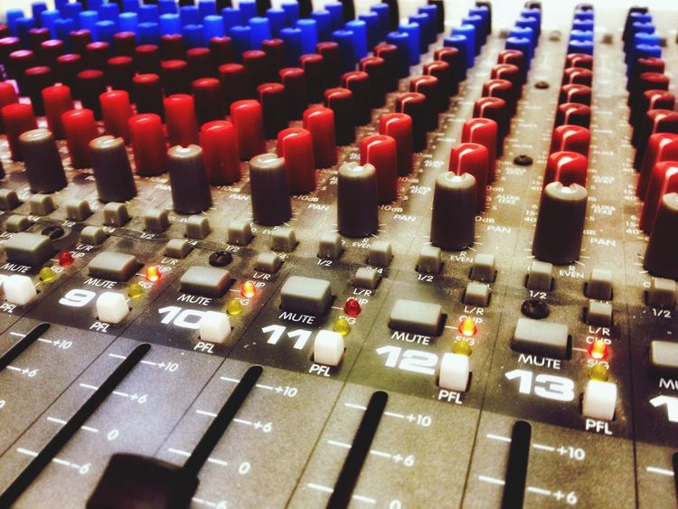 Close up of a sound desk. Sound Desk Mixing Desk Slider Sliders Dial Dials Button Buttons Switch Switches Sound Music Levels Controls Knobs