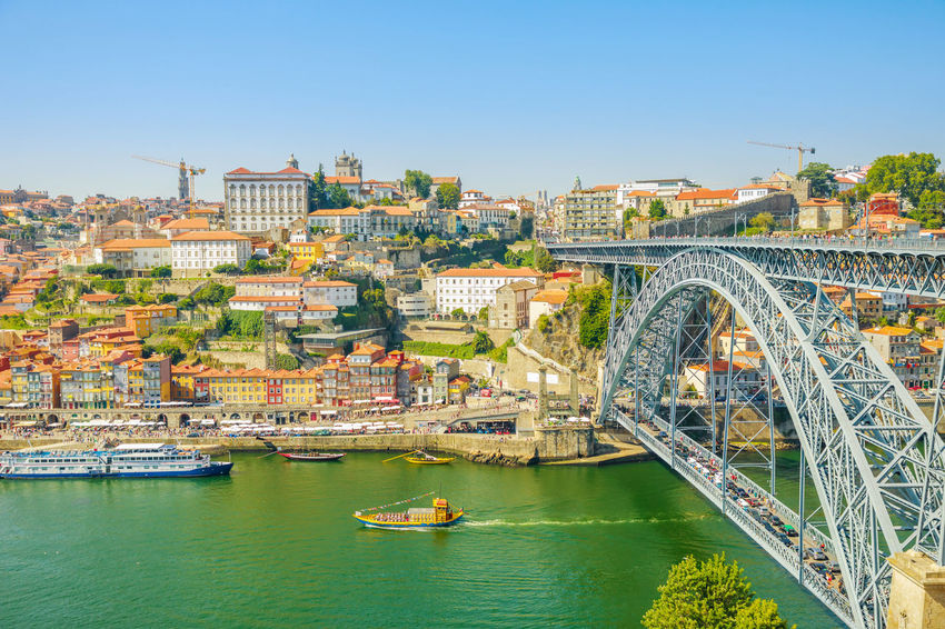 Picturesque Oporto urban landscape. Aerial view of Dom Luis I on Douro River and city skyline, Vila Nova de Gaia, Porto in Portugal. Sunny beautiful day. Portugal Porto Tourism City Aerial View Cloudscape Cityscape Landscape Panorama Europe People Church Church Architecture Architecture Town Porto Portugal 🇵🇹 Monment Oporto City Oporto Downtown Oporto Streets Douro River Portugal River Sea Bridge Transportation Water Built Structure Nautical Vessel Building Exterior Bridge - Man Made Structure Connection Mode Of Transportation Nature Sky Day Travel Travel Destinations No People Building Outdoors Arch Bridge Passenger Craft