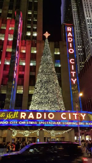 Radio City NYC NYC Photography Architecture Built Structure Night Illuminated Building Exterior Christmas christmas tree Communication Outdoors Christmas Decoration City Tree Neon