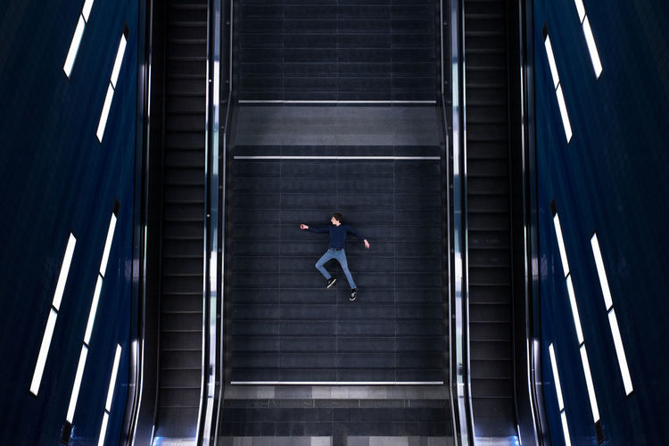 View of man on escalator