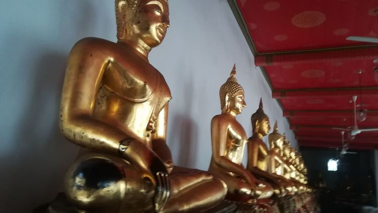 Buddha..in a row The Week On EyeEm Row Thailand Buddha Buddhism Buddha Statue Thailand Statues Travel Photography No People Statue Sculpture Religion Spirituality Gold Colored Gold Close-up Place Of Worship