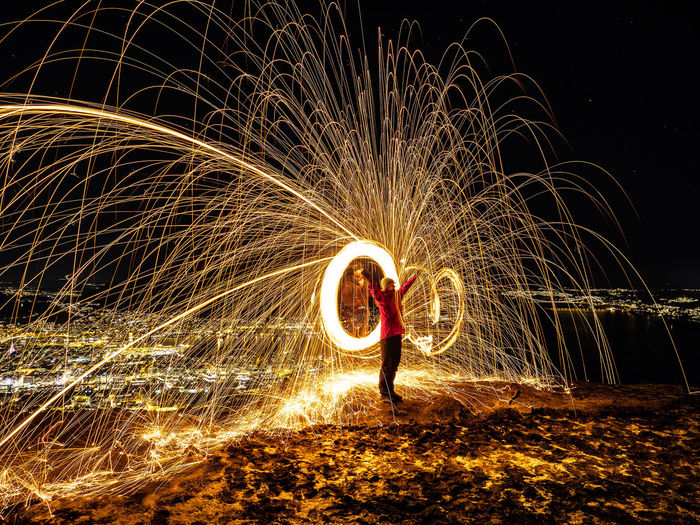 CIty lights Motion Real People One Person Illuminated Night Long Exposure Wire Wool Glowing Blurred Motion Spinning Lifestyles Standing Full Length Leisure Activity Men Arts Culture And Entertainment Burning Sparks Nature Fire Light Trail Skill  Outdoors Firework Light Painting