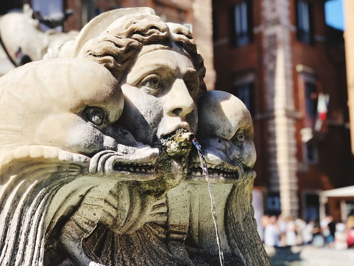 Close-up of water flowing from statue