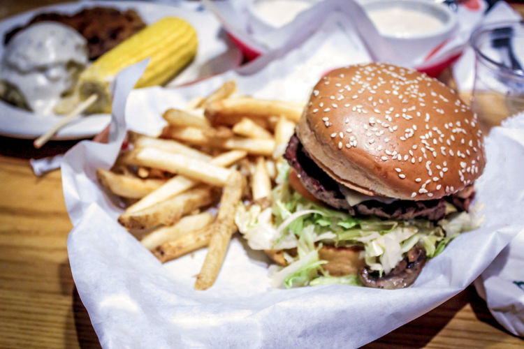 Close-Up Of Burger And French Fries On Table