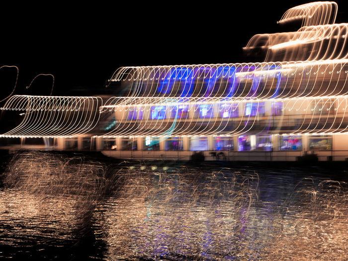 Multi colored illuminated water at night