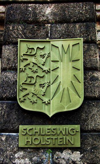 Schleswig-Holstein-Wappen am Deutschen Eck EyeEm Selects Wappen Schleswig-Holstein Rheinland-Pfalz  Deutsches Eck Koblenz Deutschland Communication Text Sign Western Script No People Day Close-up