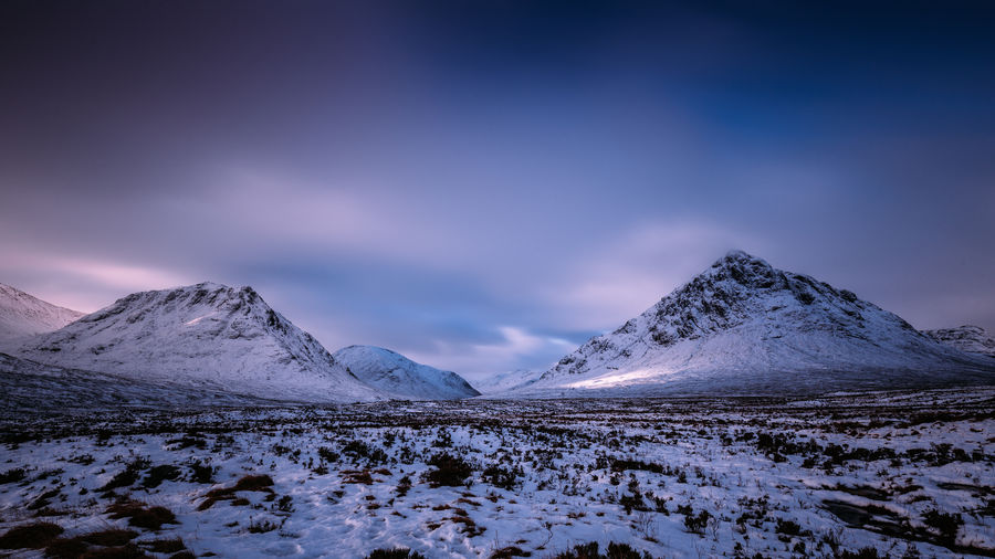 Winter snow landscape in Glencoe, Scotland, UK Winter Snow Mountain Snowcapped Mountain Scotland Uk United Kingdom Glencoe Scottish Highlands Landscape Dramatic Sky Clouds Cold Temperature Beauty In Nature Moody Sunrise
