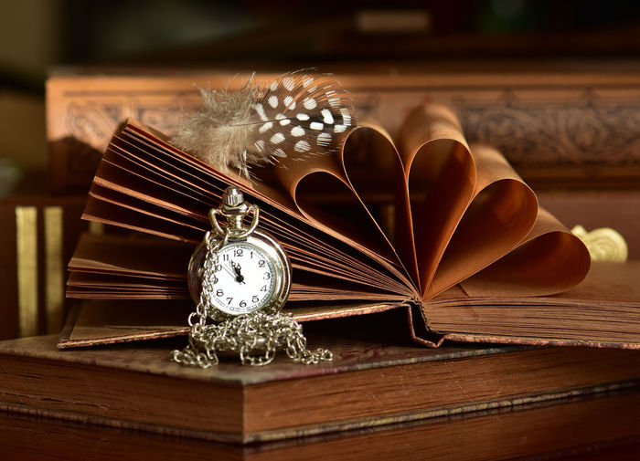 Table Indoors  Still Life Wood - Material Book Publication No People Close-up Decoration Antique Focus On Foreground Time Selective Focus Flower Jewelry Box Flowering Plant Old Clock Ornate Personal Accessory