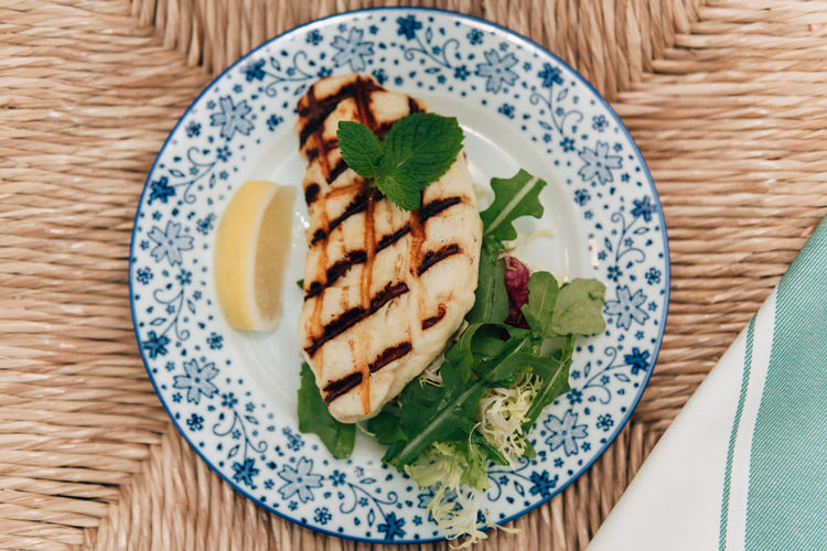 Haloumi cheese Cuisine Greek Chaloumi Cheese Close-up Directly Above Food Food And Drink Freshness Garnish Greek Food Grilled Haloumi Healthy Eating High Angle View Lemon Slice Mint Leaf - Culinary Plate Ready-to-eat Serving Size Still Life Table